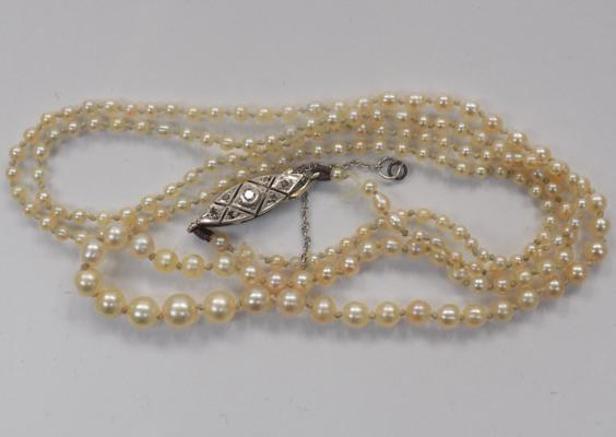 A vintage seed pearl necklace, with white metal clasp set with diamonds (tested)