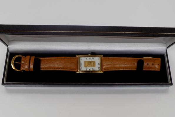 A Stauer wristwatch, with tan leather strap - and gold ingot insert