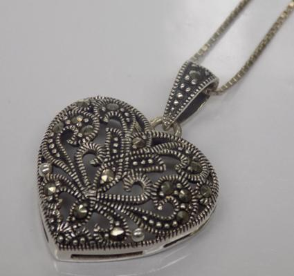 A 925 silver art deco style heart pendant, set with marcasites; on eighteen inch chain