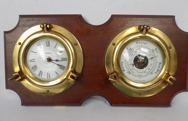 A nautical style clock and barometer