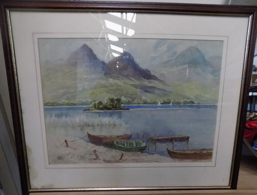 A framed watercolour by A Dransfield, titled 'Boat on Lake'