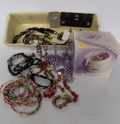 A selection of costume jewellery and cleaning kit