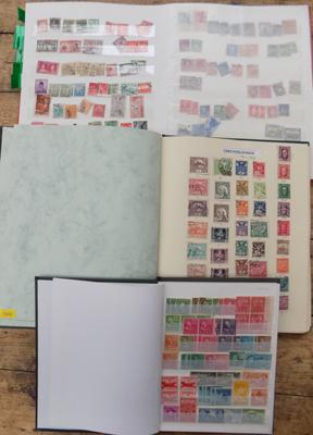 Three albums of world stamps; including USA