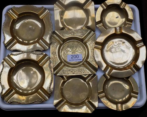 A selection of brass ashtrays