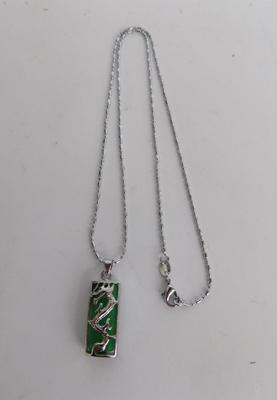 A silver necklace with jade pendant