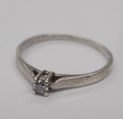 0.10ct diamond set, sterling silver solitare ring