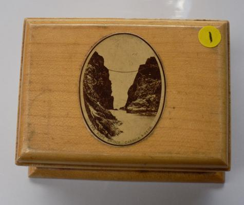 A Mauchline ware box, depicting 'The Rope Bridge at Carrick A Rede'