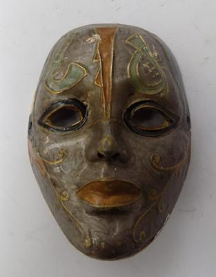 A metal, hand painted face mask - approximate size five inches
