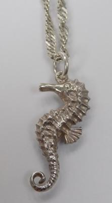 A sterling silver sea horse pendant and chain