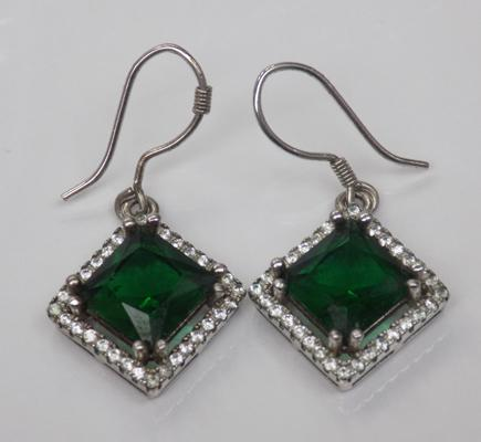 A pair of green stone set earrings
