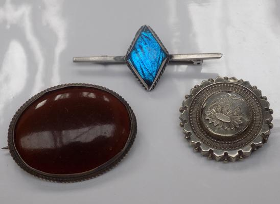 Three vintage white metal brooches; including gemstone and butterfly wing examples