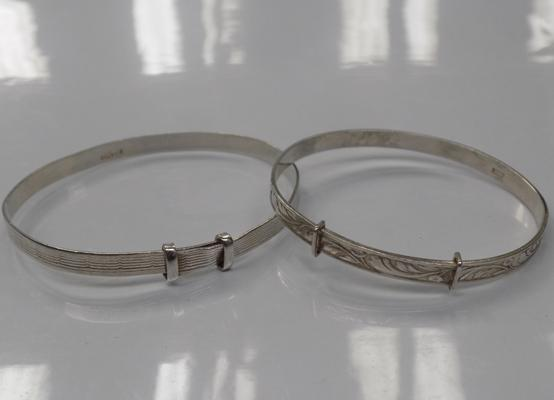 Two sterling silver christening bangles - one marked silver and the other marked sterling silver