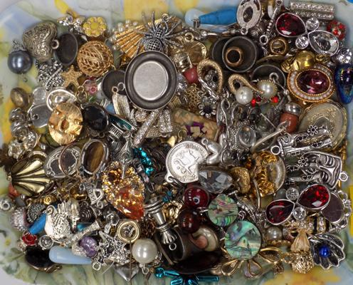 A collection of gold and silver tone charms