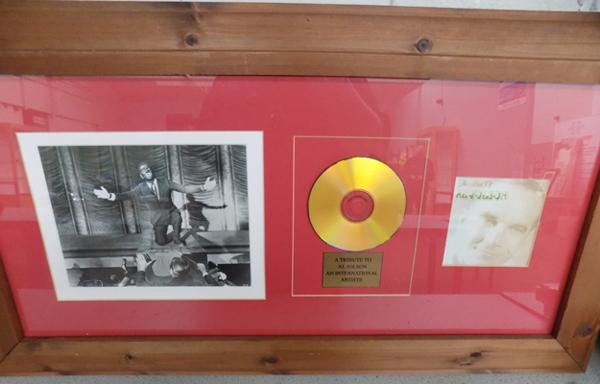 A framed Al Jolson gold tone CD and print