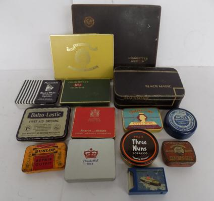 A selection of mixed tins and a gas lighter