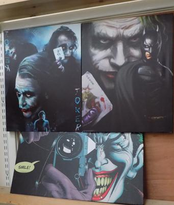 Three DC Comic's The Joker canvas prints; including Heath Ledger