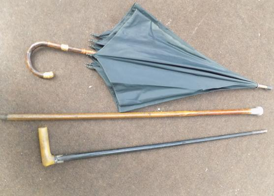 Two walking canes, one with silver top - and 18ct gold plated banded umbrella