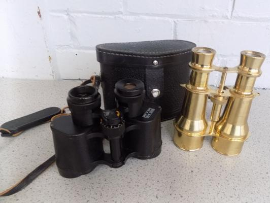 A pair of binoculars, and a pair of field glasses