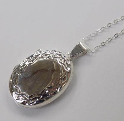 A silver locket on silver chain