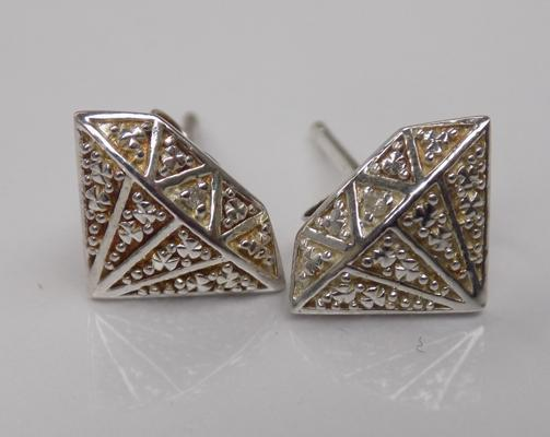 A pair of 925 silver, diamond set earrings