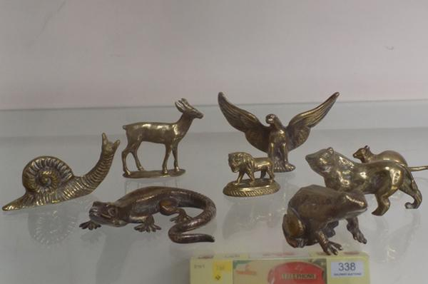 A collection of brass miniature animals; including eagle and lizard