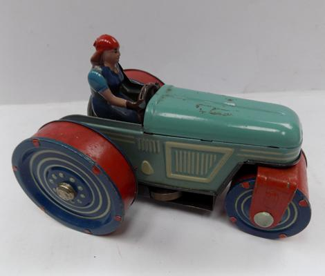 A vintage tinplate clockwork tractor, approximately six inches long - Circa 1960