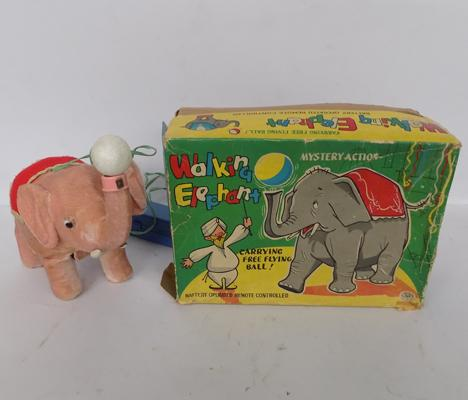 A vintage, remote controlled - walking elephant