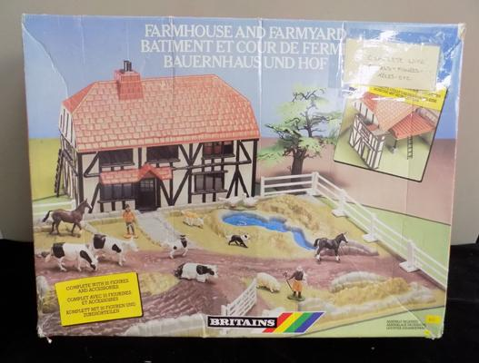 A Britains farmhouse and farmyard; with animals and figures