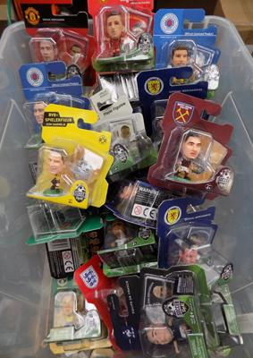 A box of approximately forty Soccer Starz figures
