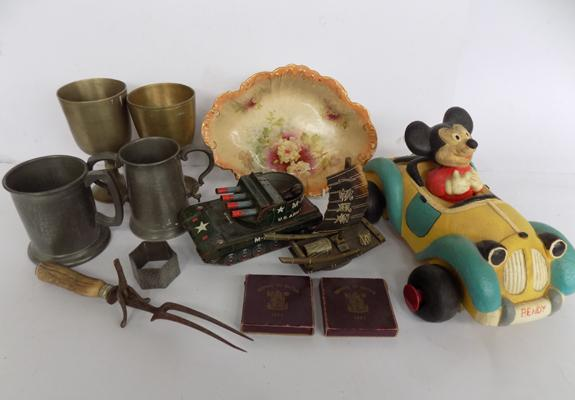 A selection of mixed items; including coins, brass goblets and toys