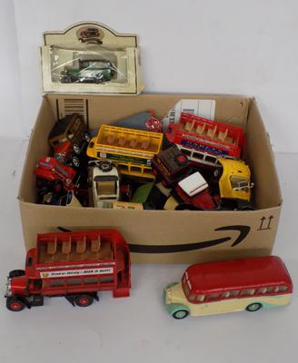 A box of mixed die cast and model vehicles
