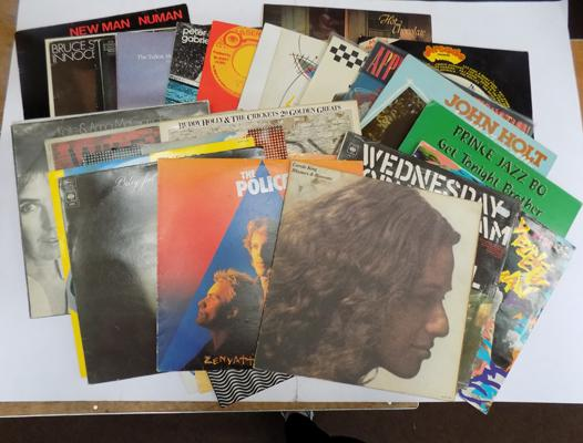 A collection vinyl LP's records; including Guns n Roses (banned cover) - The Specials, Wings, Bruce Springsteen, Dire Straits, UB40, and The Cure