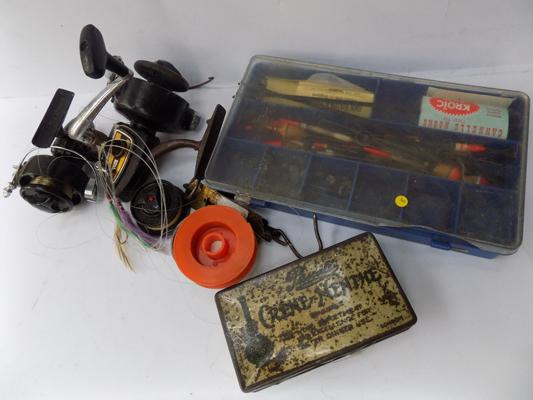 A collection of fishing related items - including reels and flies