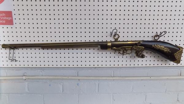 A replica antique flintlock musket; approximate length 40 inches