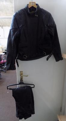 A set of motorbike leathers; jacket and trousers