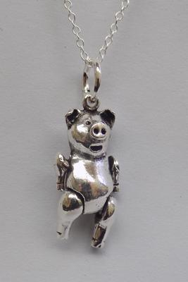 Silver articulated pig pendant on silver chain