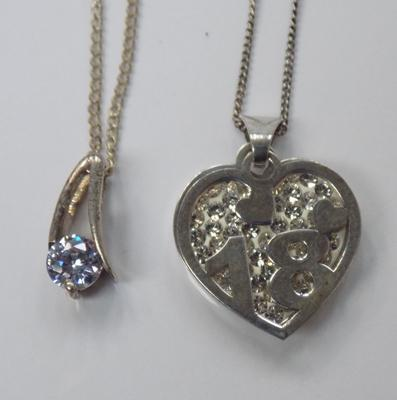 2 silver necklaces with pendants