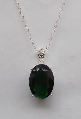 Silver and green stone set pendant on silver chain