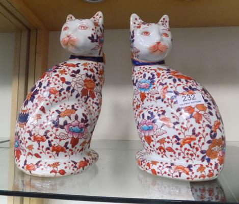 Pair of oriental cats with stamp to underside