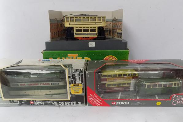 Three Corgi boxed buses