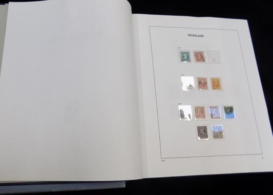 Boxed album of early Netherlands stamps