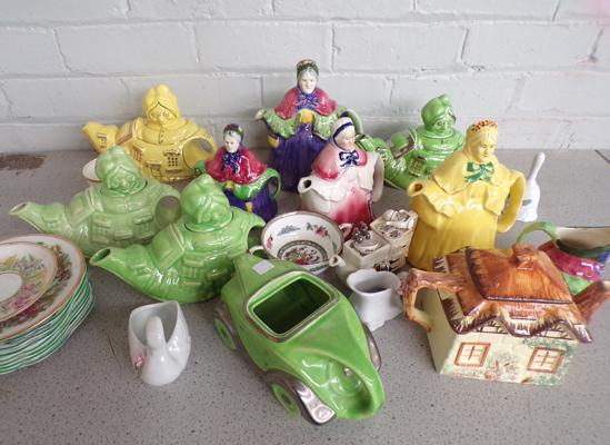 Box of decorative teapots