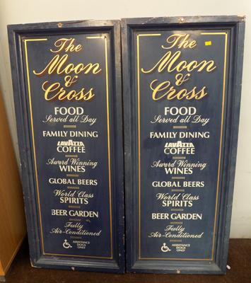 Two wooden pub signs