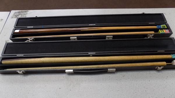 2 snooker cues in cases