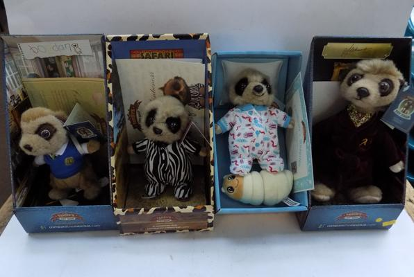 Four Meercat dolls with certificates of authenticity