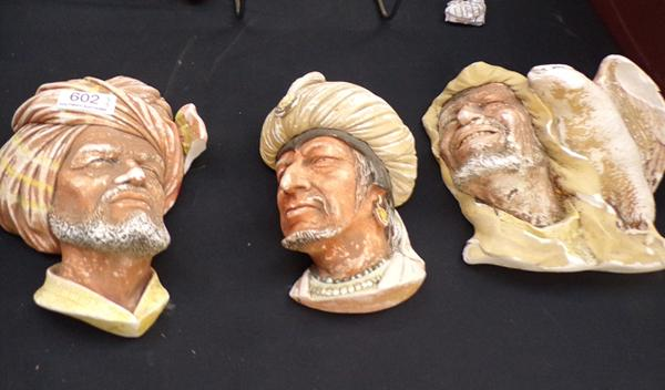 Three wall hanging face plaques - Arab Bossons