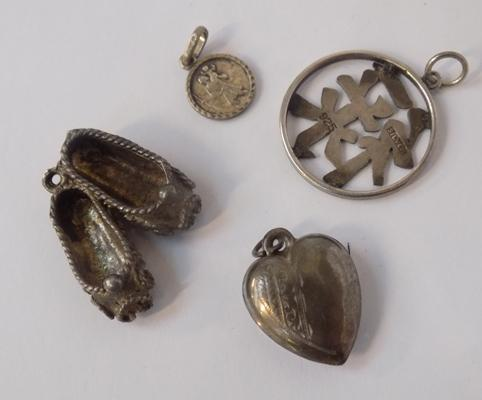 Four silver pendants