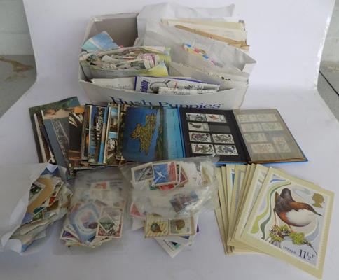 Shoe box full of stamps, postcards, 1st day covers and small book with early stamps