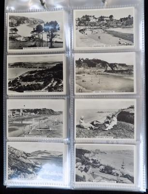 9 full sets of cigarette cards in album