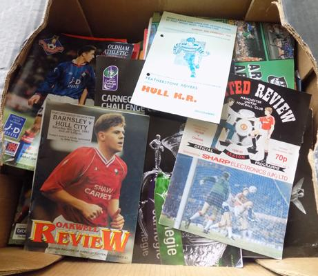 Box of football programmes